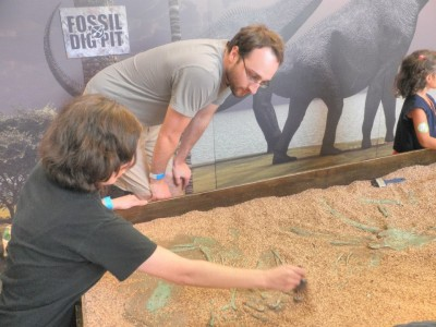 Students uncovering fossils at science musem